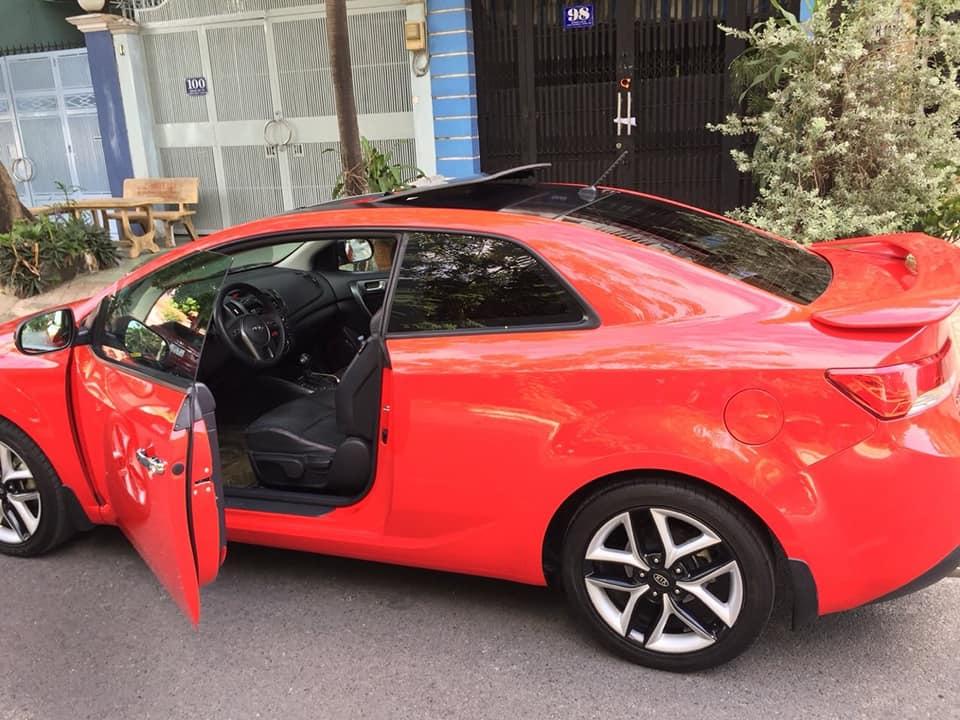 cần bán cọp Cerato 2011, số tự động, 2 cửa màu đỏ, còn mới tinh