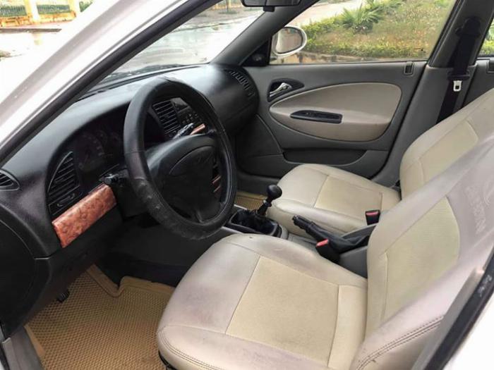 Cần bán Nubira 2002, số sàn, màu trắng gia đình sử dụng kỷ, xe còn mới 80%
