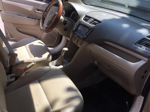 Cần bán Suzuki Ertiga 2016 số tự động màu vàng cát, nhập khẩu 0