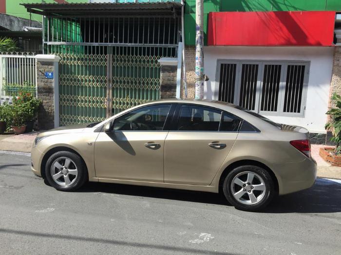 Bán Chevrolet Cruze LS 2011 số sàn màu vàng gia đình chính chủ 0
