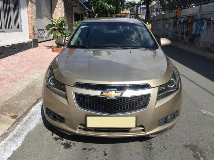 Bán Chevrolet Cruze LS 2011 số sàn màu vàng gia đình chính chủ