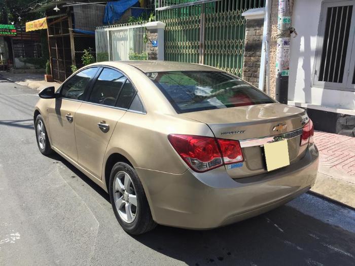 Bán Chevrolet Cruze LS 2011 số sàn màu vàng gia đình chính chủ 2