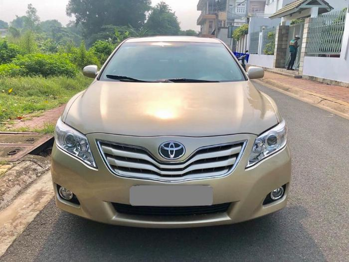 Bán Toyota Camry LE 2010 màu vàng xe zin nguyên như mới.