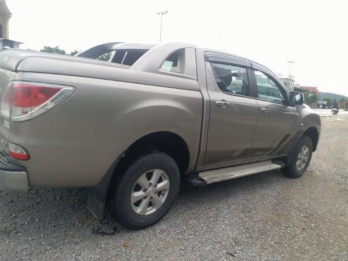 Cần bán xe BT50, sản xuất 2014, số sàn, máy dầu, hai cầu, màu ánh kim