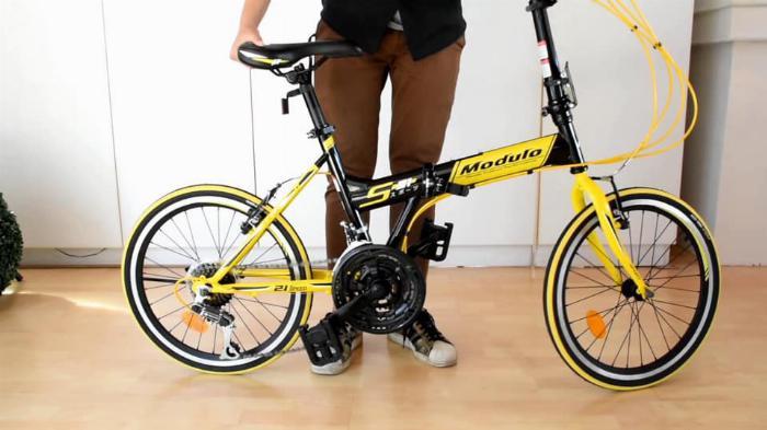 Xe đạp gấp , mới 100% , màu vàng,còn nguyên thùng
