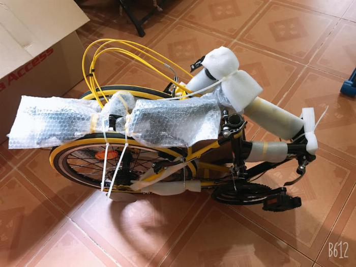Xe đạp gấp , mới 100% , màu vàng,còn nguyên thùng 2