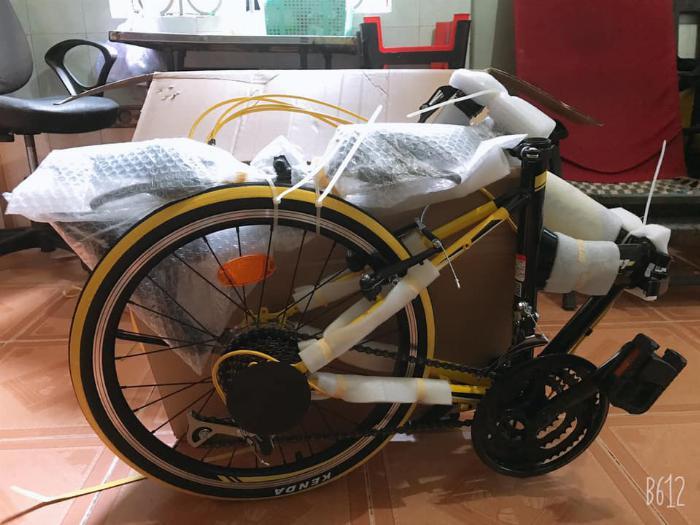 Xe đạp gấp , mới 100% , màu vàng,còn nguyên thùng 4