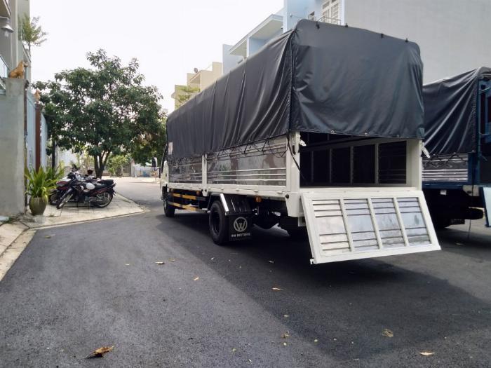 Đại lý xe tải isuzu 1t9 - thùng bạt 6m2 chở hàng bao bì giấy vào thành phố 1