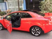 cần bán cọp Cerato 2011, số tự động, 2 cửa màu đỏ, còn mới tinh.