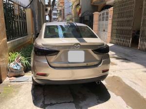 Cần bán xe Mazda 2 2017 số tự động màu vàng cát, nội thất đen rất đẹp, xe 1 đời chủ bstp