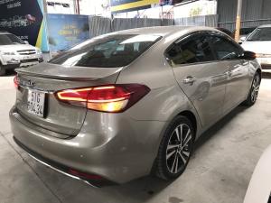 Bán Kia Cerato 1.6AT màu vàng cát số tự động sản xuất 2018 biển Sài Gòn xe như mới