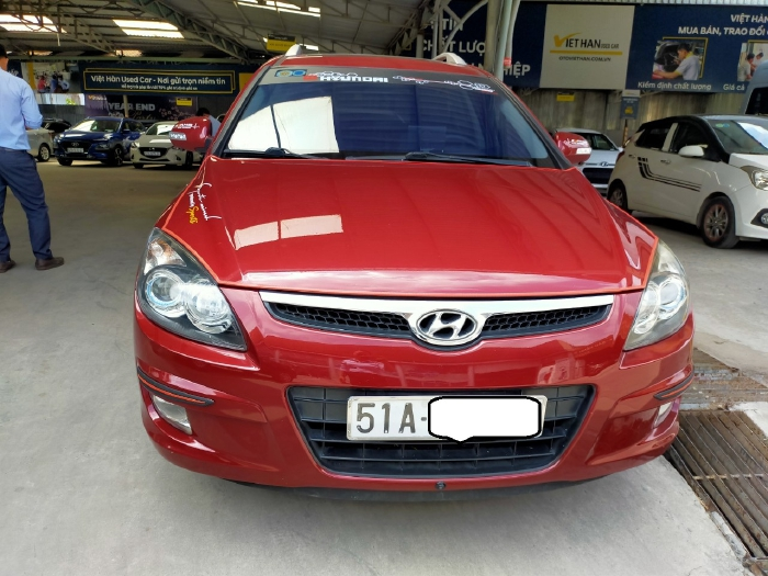 Hyundai I30 CW 1.6AT 2010 màu đỏ biển SG xe siêu đẹp 2